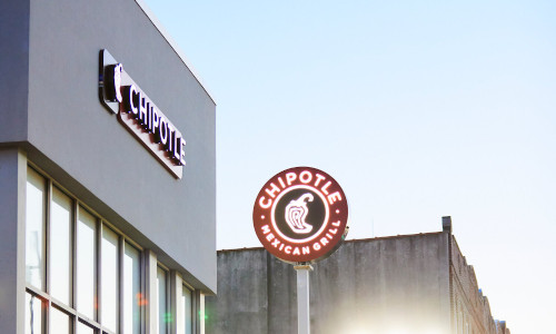 """A car headed to a """"Chipotlane,"""" which Chipotle hopes lets customers drive away with food in less than a minute."""